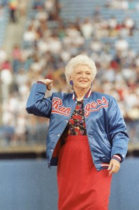 Barbara Bush tossing out the first ball of the new Texas Rangers team, 1989. (Corbis)