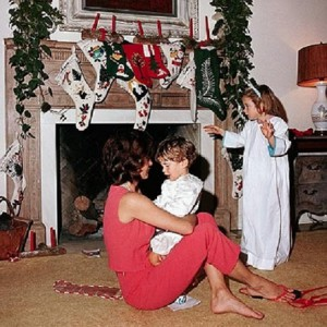 Jacqueline Kennedy holds her nephew as her daughter watches during the family Christmas Eve gathering in 1962 (JFKL)