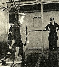 Edith Wilson stands behind her husband as they sail to Europe in 1919. (WWPL)