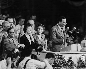 Frances Dewey (black hat) stands behind her husband as he makes his acceptance speech at the 1948 Republican Convention.  (UNiversity of Rochester)