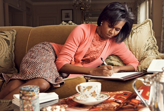 Michelle Obama writing, in her Chicago home. (twodelighted.com)