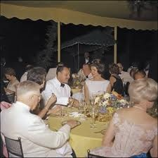 Seen here during the state dinner the Kennedys hosted by Pakistan's president at Mount Vernon, Jacqueline Kennedy innovated these traditional events by using round, rather than square tables. (JFKL)