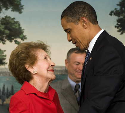 US President Barack Obama (R) speaks with former US first lady Nancy Reagan (L) after signing the Ronald Reagan Centennial Commission Act in the Diplomatic Room of the White House in Washington, DC, June 2, 2009. (Getty)