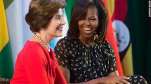 A lighter moment between First Ladies Bush and Obama. (Reuter's)