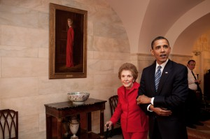 Former First Lady Nancy Reagan escorted by President Obama during a 2009 White House visit, as they pass her portrait. (The White House)