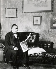 "McKinley on his famous black leather couch in the office he created in the ""Campaign House.""  (Harper's Magazine)"