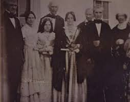 Secretary of State James Buchanan and Harriet Lane stand at far left, along with Miss Rucker, First Lady Sarah Polk, President James Polk and former First Lady Dolley Madison for a photograph on the White House South Portico, circa 1845. (Eastman House)