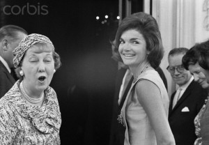 Mamie Eisenhower calls out a response to reporters before joining Jacqueline Kennedy for a June 22, 1962 lunch meeting on their joint National Cultural Center endeavor. (Bettman/Corbis)