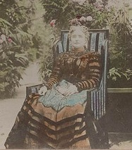 A colorized image of Ida McKinley, seated in the White House greenhouse. (Library of Congress)