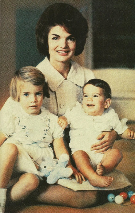 First Lady Jacqueline Kennedy shortly after m moving into the White House with three-year old daughter Caroline and several-mont