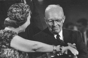 Showing off a new charm for her bracelet to Preisdent Eisenhower at the 1956 convention which re-nominated him for a second term.