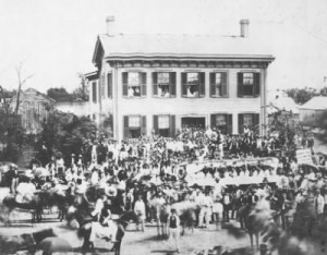 The Springfield, Illinois home of Abraham Lincoln during a campaign event. Mary Lincoln has been identified as sitting in the upper left window. (LC)
