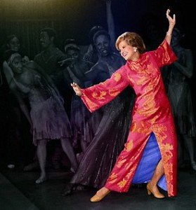 Betty Ford dancing with Judith Jameison of the Dance Studio of Harlem in her favorite Chinese-style gown. (Corbis)