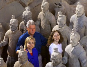The President and Mrs. Clinton pose with their daughter Chelsea with the famous terra cotta warrior figures on their second of a nine-day state visit to China (Reuter's