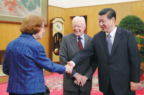 Former President Carter introduces Rosalynn to Communist Party leader Xi Jinping during one of their Chinese trips. (ecns.cn)