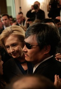 The blind Chinese dissident Chen Guangcheng and Hillary Clinton finally met when both were awarded the 2013 Tom Lantos Human Rights Prize on December 6, 2013. (zimbio.com)