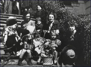 Eleanor Roosevelt sits with European refugee children who she invited as her personal guests on the South Portico steps during the Easter Egg Roll.