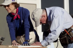 Former First Lady Rosalynn Carter helping build a home with her husband through Habitat for Humanity. (sfgate.com)