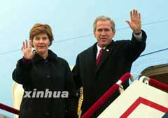 George and Laura Bush arrive in China 2002.