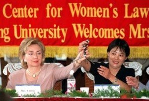 Hillary Clinton with Beijing University's women's legal aid society members during her second trip to China in 1998. (AP)