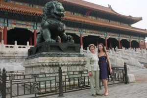 First Lady Laura Bush and her daughter Barbara pause next to a Fu Dog during their August 2008 visit to Beijing's Forbidden City. (GWBPL)