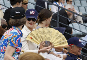 Laura Bush fans herself while watching the U.S. men's baseball team play a practice game against the Chinese team  August 11 at the 2008 Summer Olympics in Beijing. (GWBL)