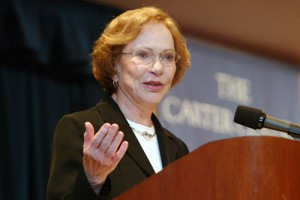 Mrs. Carter speaking at a symposium on mental health. (cartercenter.org)