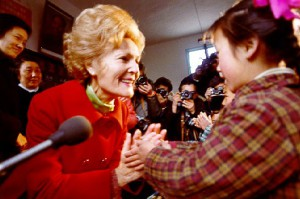 Pat Nixon warmly engages with a young Chinese schoolgirl. (AP)