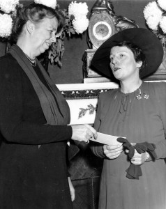 Pearl Buck receiving a check from First Lady Eleanor Roosevelt for the China Relief Legion. (National Geographic)