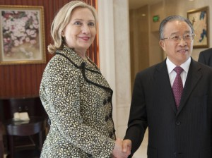Senior Chinese official Dai Bingguo and Secretary of State Hillary Clinton shook hands before their meetings in Shenzhen, China, July 2011. (AP)
