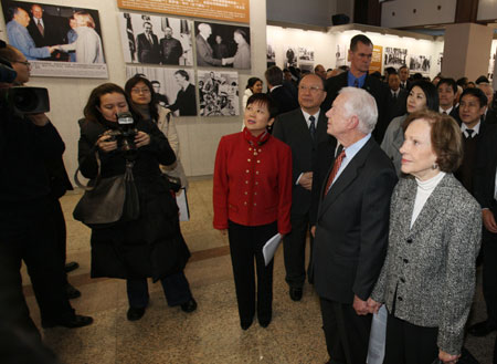 The Carters at the opening of a photo exhibition commemorating the 40th anniversary of economic  freedoms initated by him and Deng. (chinaconsulatechicago.org)