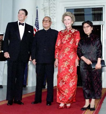 To honor China's President  Li Xiannian at the July 1985 state dinner honoring him, Nancy Reagan wore the Chinese gown given to her as a gift when she visited China. (RRPL)