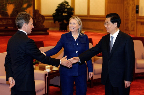 U.S. Secretary of State Hillary Clinton introduces U.S. Treasury Secretary Timothy Geithner  to Chinese President Hu Jintao during a meeting at the Great Hall of the People in Beijing on May 4, 2012. (Getty)