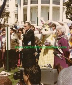 George Bush and Barbara Bush preside over an Easter Egg Roll contest.