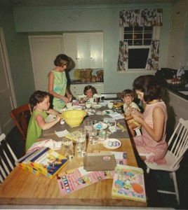 Jackie Kennedy coloring eggs with her son John. Her daughter Caroline and family friend Sally Fay at Eastertime 1963.