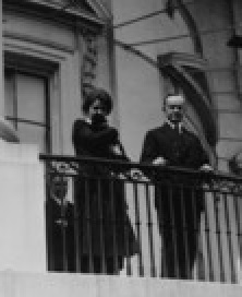 Overlooking crowds from the South Portico on April 21, 1924, Grace Coolidge brought and held one of the family cats, while the President made his only known appearance at an annual Easter Egg Roll.
