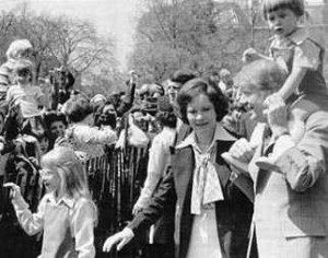 Rosalynn Carter and her family at the 1977 Easter Egg Rool, the President holding his grandson Jason on his shoulders.