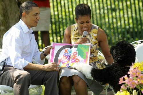 The President and Mrs. Obama read to children as Bo takes attention at the 2011 White House Easter Egg Roll.(Getty)