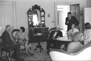 Lady Bird Johnson in the Lincoln Bedroom with photographer Edward Steichen and Lincoln scholar Carl Sandburg. (LBJL)