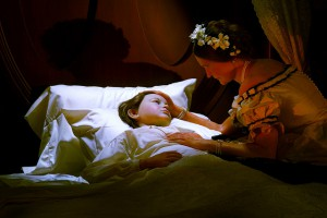 A Lincoln Presidential Museum depiction of Mary Lincoln at the sickbed of her son WIllie. (flickr)