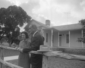 Lyndon and Lady Bird Johnson at the wood fence of their beloved LBJ Ranch, November 1964. (LBJL)