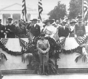 Edith Wilson joins her husband and Assistant Navy Secretary Franklin Roosevelt in review of Second Division, U.S. Marines on August 12, 1919.