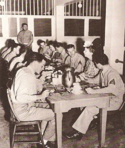 Eleanor Roosevelt eats dinner with U.S. Army servicemen based in the Virgin Islands.