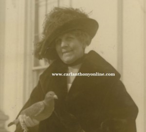 Florence Harding, with a carrier pigeon.