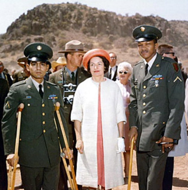 Lady Bird Johnson with two wounded servicemen, returned from the war in Vietnam, at a Fort Davis National Monument dedication ceremony in 1966. (LBJL)
