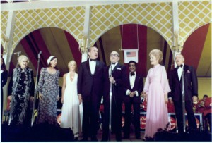 Pat Nixon, in a pink gown, with the President, hosting the large state dinner for returning Vietnam War prisoners of war. (RNPL)