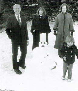 The President, Mrs. Carter, daughter Amy and Peggy Fleming with a snowman at the outdoor party.