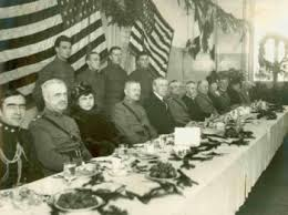 Edith Wilson seated besides General Pershing at Christmas 1918 dinner in France, just after World War I's end.