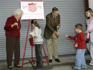 Barbara Bush joined by the former President ringing a Salvation Army Bell for donations in her post-White House years.