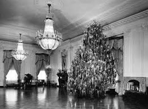 The tinseled East Room tree under Eisenhower.